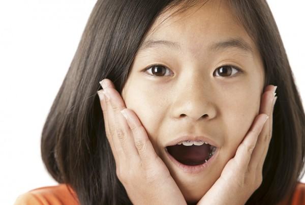 Surprised Asian Little Girl Closeup Headshot